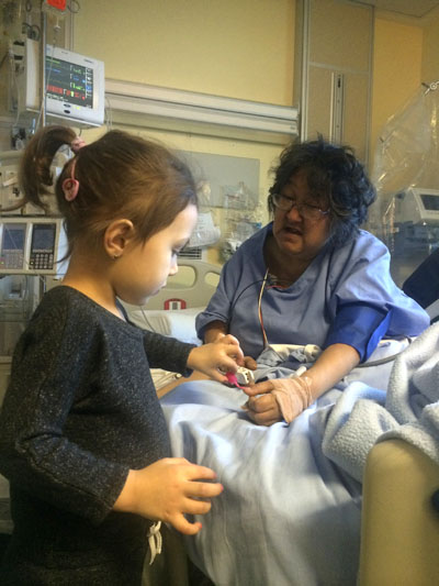 The late Annie Kootoo with her granddaughter on Dec. 29, 2014, before being medevaced to Ottawa on Dec. 30, 2014. She died Jan. 3, 2015. (PHOTO COURTESY OF BERNICE CLARKE)