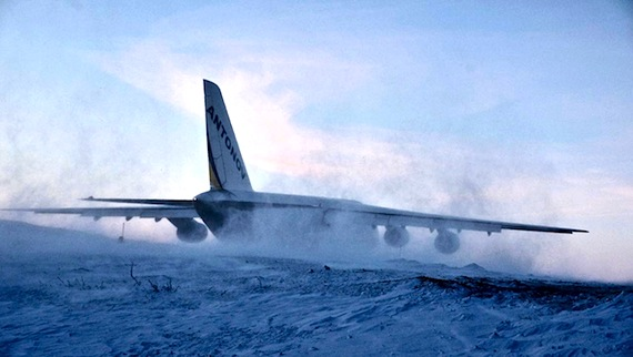 The Antonov lands in a cloud of snow Feb. 4 as it touches down,  at the Iqaluit airport: Now the work starts for the repair crew on the Swiss International Airlines jet. (PHOTO BY FRANK REARDON PHOTOS)