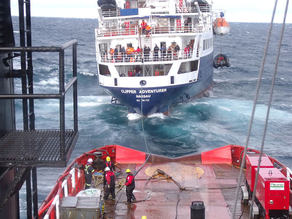 A photo from August 2010 shows a Canadian Coast Guard ship towing the Clipper Adventurer. (FILE PHOTO)