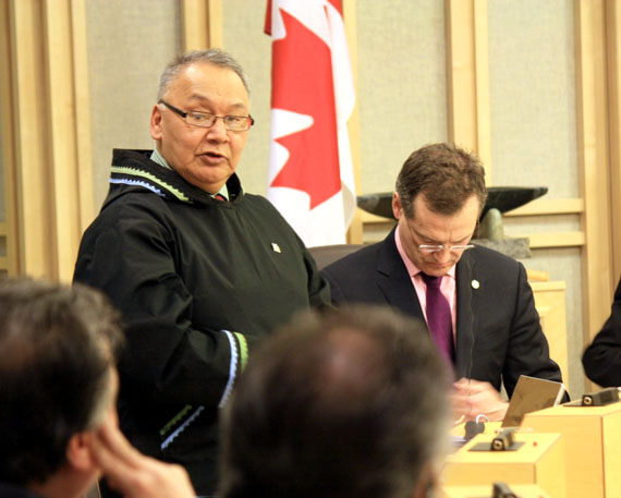 Johnny Mike, minister responsible for the Qulliq Energy Corp., pictured here with Finance Minister Keith Peterson in 2015, says the Government of Nunavut is still seeking alternatives to diesel-power generation in the territory. That includes hydroelectric power, even though the government halted plans for the Iqaluit hydro project in 2014. (PHOTO BY PETER VARGA)