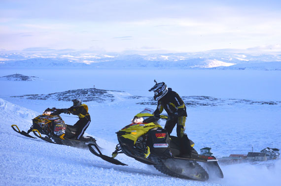Contestants take part in the uphill snowmobile climb during Toonik Tyme 2016. (PHOTO BY STEVE DUCHARME)