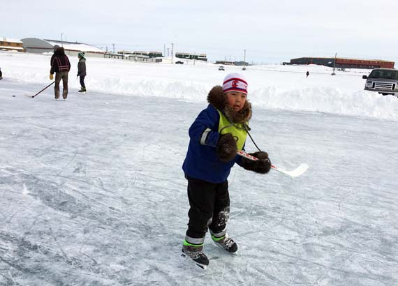 Jackie Nakoolak takes a spin around frozen Willliamson Lake, the popular hockey rink in the centre of Rankin Inlet. The outdoor rink is maintained by the hamlet's recreation staff throughout the winter and spring. (PHOTO BY NOEL KALUDJAK)