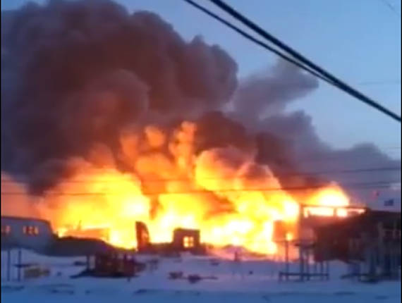 Kugaaruk's Kugaardjuq school has been destroyed in a fire that started Feb. 28. Education officials are travelling to the Kitikmeot community Mar. 1 to identify alternate classroom space for the community's 300 students. (IMAGE COURTESY OF B. TINAK)