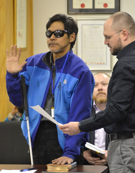 Former, and now newly-elected, Iqaluit Coun. Noah Papatsie swears his oath of office April 25 before a city council meeting.
