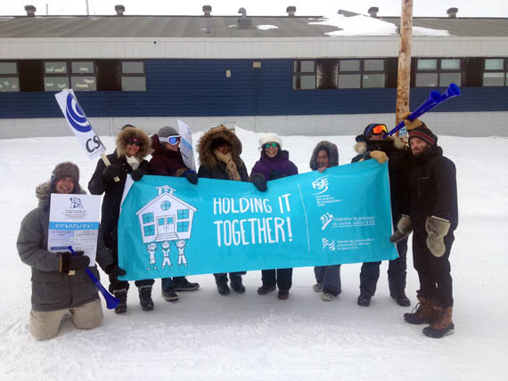 Quaqtaq teachers, professionals and support staff demonstrate outside the community's Isummasaqvik school April 26. They're asking the KSB to table its demands so their union can finalize their contract negotiations after two years of talks. (PHOTO COURTESY OF AENQ)