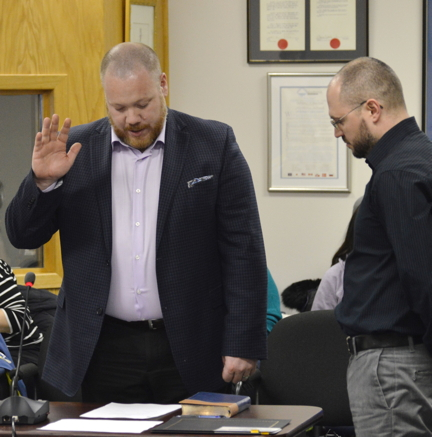 Iqaluit Coun. Kyle Sheppard swears his oath of office April 25. He was elected to council in a byelection April 10. (PHOTOS BY STEVE DUCHARME)
