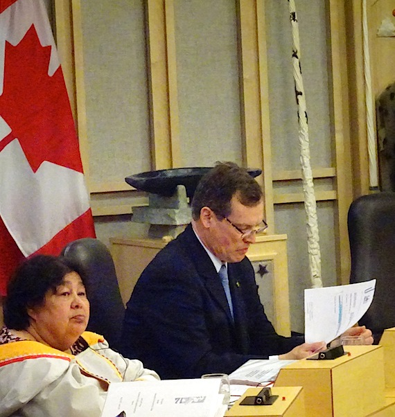 Nunavut Finance Minister Keith Peterson, to the right, next to Monica Ell-Kanayuk, Nunavut's Deputy Premier, speaks May 30 in the Nunavut Legislature. (PHOTO BY JANE GEORGE)
