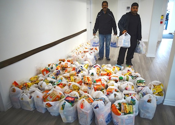 The top photo of the week on the Nunatsiaq News Facebook page, based on views, likes and shares, show an Iqaluit mosque distributing free food to the hungry in Iqaluit Iqalungmiut lined up June 3 at 1 p.m. at the Iqaluit mosque to receive one of 72 bags of food donated, packed and distributed by members of the Muslim community. Syed Asif Ali, president of Islamic Society of Nunavut, said the food distribution was a way of responding to the city's show of solidarity and love after the deadly attack on a Quebec City mosque earlier this year.