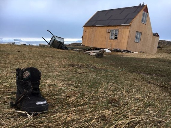 A house, battered by the June 18 tsunami, and a lone boot: one of the sad scenes photographed in Nuugaatsiaq this week by the Arctic Joint Command.