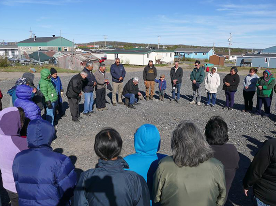 Kuujjuamiut gather to bless the site of the Nunavik community's new St. Stephen's Anglican church, which is set to be constructed this summer on a vacant lot in the community's core. The new church is designed to have seating for 210 people, with room to accommodate 266 on special occasions. The Diocese of the Arctic has operated an Anglican mission in the region since 1899. (PHOTO BY ALLAN GORDON)