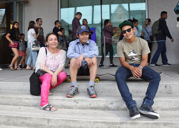 Alasuak Akesuk, her son and artist Latch Akesuk and Parr Josephie pictured outside of the Art Gallery of Ontario June 28 ahead of the opening of an exhibit featuring the work of the two Cape Dorset youth. (PHOTO BY SARAH ROGERS)