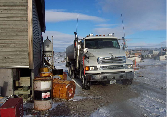A truck delivers water to a home in Nunavut. Residents of Whale Cove are on another boil water alert, while the GN tries to find the course of coliform in the community's drinking water. (FILE PHOTO)