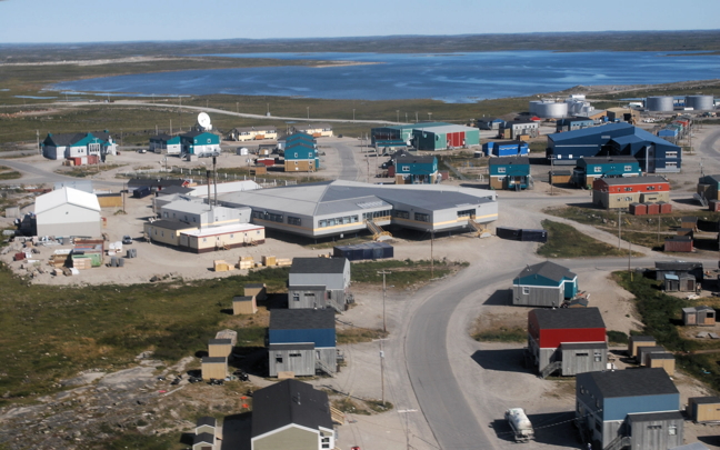 The Inuulitsivik Health Centre in Puvirnituq, centre gray building. Minnie Akparook worked in Puvirnituq for 13 years. (FILE PHOTO)