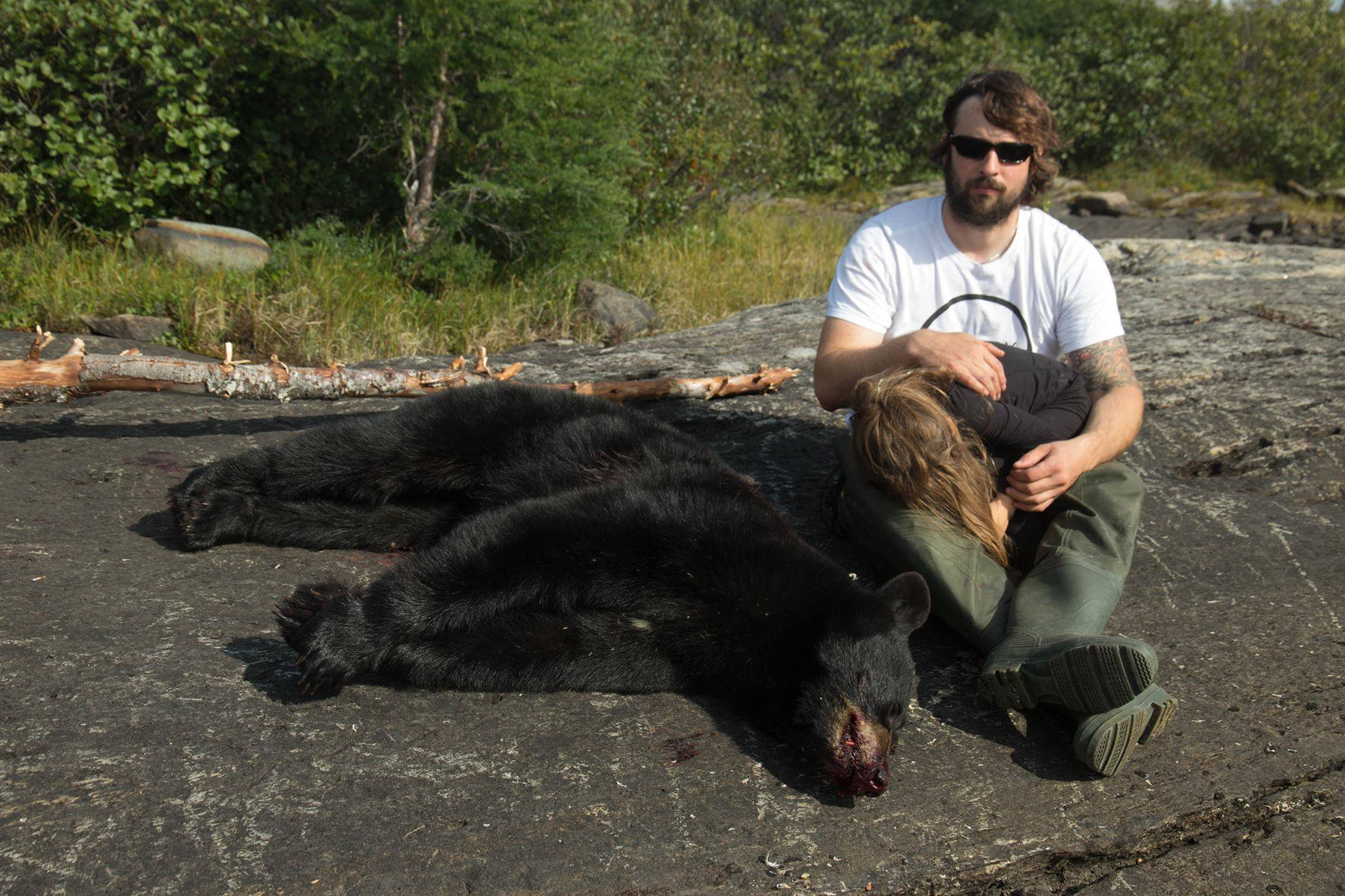Samuel Hamel-Ratté is pictured holding his five-year-old daughter, Charlie, and seated next to the female black bear he shot and killed last weekend when the animal got within 10 feet of the young girl. (PHOTO COURTESY OF S. HAMEL-RATTE)