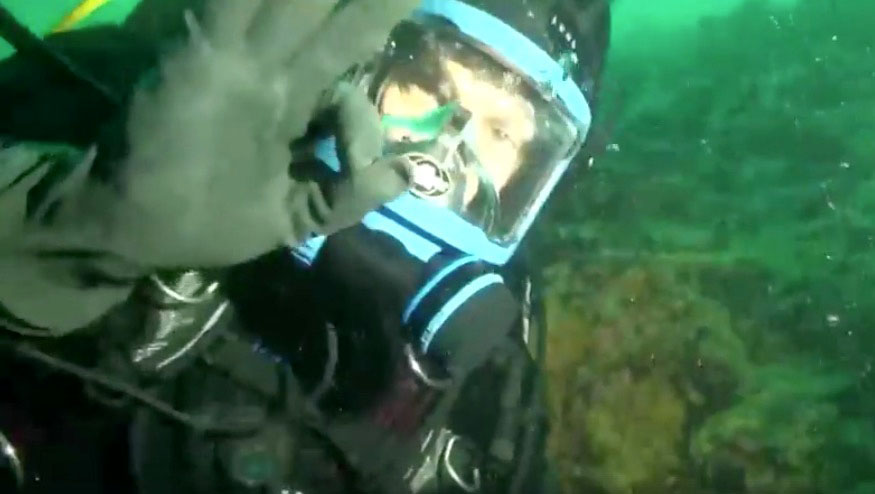 "A diver with the Fish Eye Project, a group of ocean educators in B.C., signals an ""OK"" during an underwater dive that was broadcast from Cambridge Bay Aug. 27. (PHOTO COURTESY OF CANADA C3)"