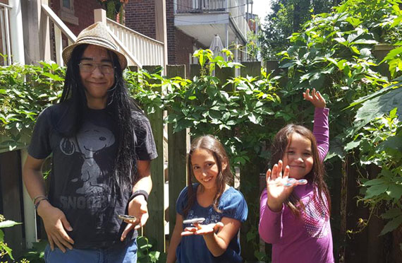 Tia and Piujuq's young cast includes (from left) Alexandre Apak Cousineau, 16, Tia Bshara, 10 and Nuvvija Tulugarjuk, 10. The three are pictured here playing with fidget spinners while on a break from their Montreal shoot last month. (PHOTO BY S. COHN-COUSINEAU/ARNAIT)