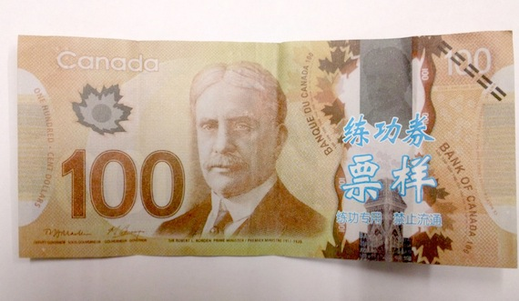 This $100 bill features Sir Robert Borden, Canada's eighth prime minister, who led the country through the First World War. But the bill doesn't include the pale blue writing that prompted the RCMP to issue a warning about counterfeit currency now circulating in Iqaluit. (HANDOUT PHOTO)