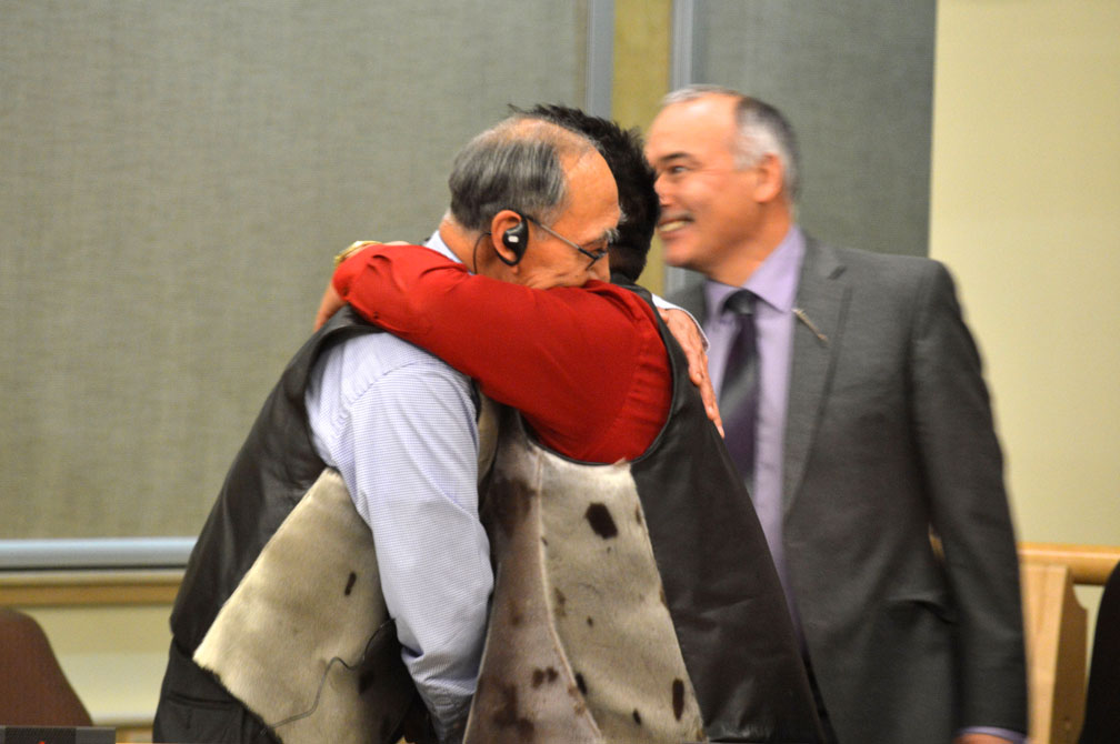 Nunavut's premier-elect, Paul Quassa, embraces Patterk Netser, the MLA-elect for Aivilik. Netser was one of three other members who Quassa defeated to win the premier's job by secret ballot in a vote held Nov. 17 among Nunavut's 22 MLAs-elect. PHOTO BY STEVE DUCHARME)
