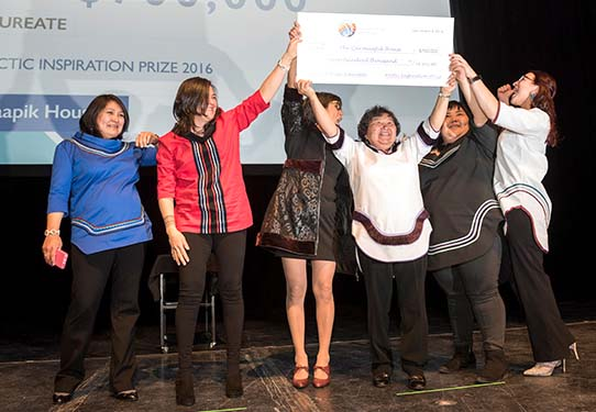 Qarmaapik House project leaders celebrate their Arctic Inspiration Prize win at the organization's December 2016 gala in Winnipeg. The Kangiqsualujjuaq-based Qarmaapik House won the AIP's top prize of $700,000 for its family-focused centre, which offers health and social services, parenting support and crisis intervention. (FILE PHOTO)