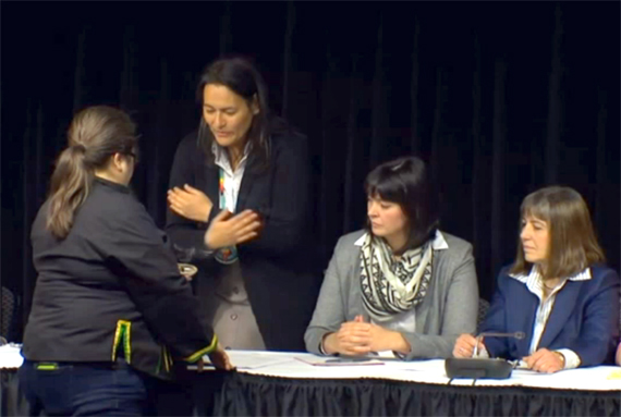 Inquiry commissioner Michèle Audette stands during a smudging ceremony at a commission press conference earlier this year. (CPAC IMAGE)