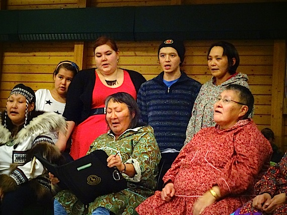 Kitikmeot Inuit Association program co-ordinators Julia Ogina (bottom, second from left) and Sarah Jancke (top, second from left) sing at KIA's community feast. Every year the Inuit language authority recognizes efforts to preserve and promote the language—but recipients must be nominated to be considered for an award. (PHOTO BY JANE GEORGE)