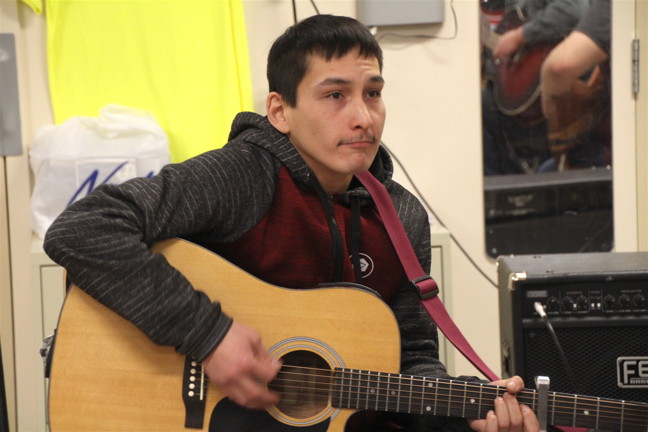 Lazarus Qattalik jams with Iqaluit musicians during an Alianait practice session Jan. 17. (PHOTO BY BETH BROWN)