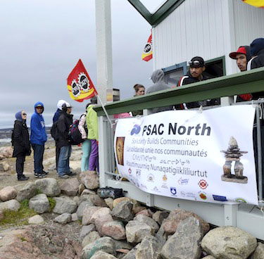 People line up for food at the annual Labour Day barbecue held by the Northern Territories Federation of Labour and the Public Service Alliance of Canada Sept. 2, 2013 at Sylvia Grinnell Park in Iqaluit. Unions in the three territories have now launched a campaign for a $15-an-hour minimum wage in Nunavut, the Northwest Territories and Yukon. (PHOTO BY DAVID MURPHY)