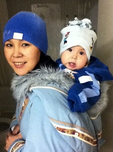 Tracy Uttak is pictured wearing her second youngest child in her amautik. The 26-year-old Igloolik mother was killed during a 2012 home robbery. (FILE PHOTO)