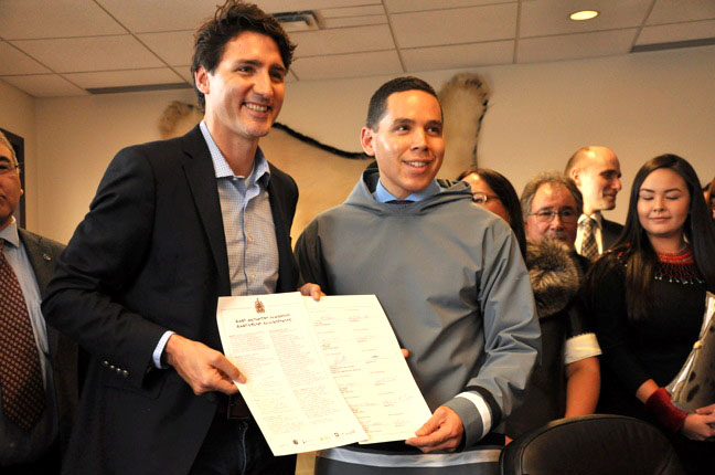 Natan Obed, president of Inuit Tapiriit Kanatami, with Prime Minister Justin Trudeau in Iqaluit on Feb. 9, 2017, when they signed the landmark Inuit-Crown partnership agreement. One of the Inuit priorities communicated through that process is federal government action on combating tuberculosis, which led to a $27.5-million commitment yesterday on the elimination of TB from Inuit Nunangat. (FILE PHOTO)