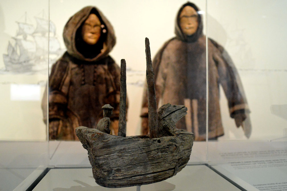 Mannequins in Inuit-style sealskin parkas look over an Inuit wood carving depicting a European-style ship from about the 1500s. (PHOTO BY STEVE DUCHARME)