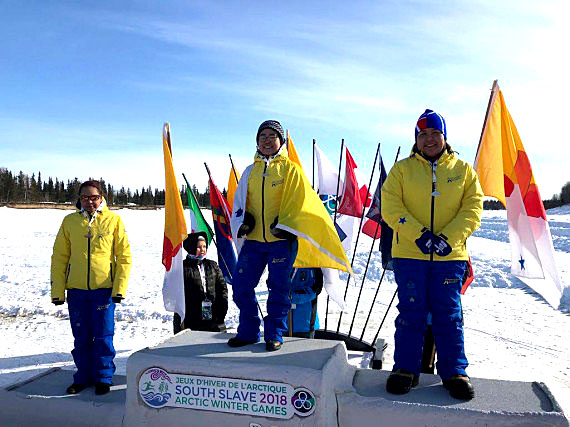 Arctic Bay athletes owned the podium for the snow snake competition at the Arctic Winter Games in the South Slave region of the N.W.T. on Tuesday, March 20. From left: Kristine Qamaniq Oyukuluk won bronze, Crystal Qaunnaq Enoogoo won gold and set a new record, and Elvina Natanine won silver.  (PHOTO COURTESY TEAM NUNAVUT)