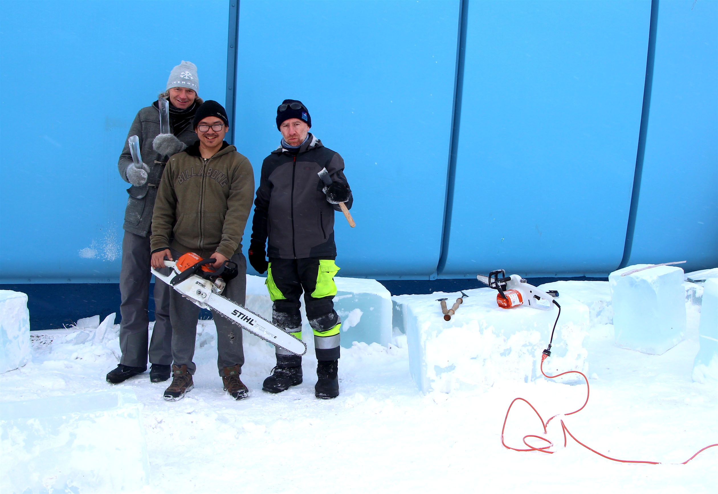 Ice Music's Terje Isungset, left, Iqaluit's Jimmy Nukiruaq and ice carver Eric Mutel cut these blocks of ice earlier this week. (PHOTO BY BETH BROWN)