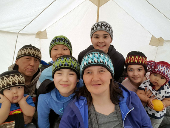 To celebrate the arrival of spring, Lorna Tatty of Rankin Inlet sent Nunatsiaq News this photo of herself with her husband, children and grandchildren sporting knit hats in their tent set up outside the Kivalliq community during last year's spring fishing derby. The first day of spring brought sunshine and temperatures in the high -20s to the Kivalliq. The family's knit hats were all made by Eva Kadlak. (PHOTO COURTESY OF L. TATTY)