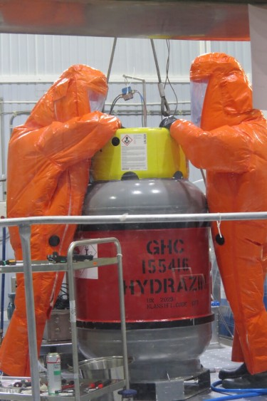 This is how you should dress if you're handling hydrazine fuel. These experts wear pressurized Hazmat suits while fueling the Copernicus Sentinel-3B satellite and pressurizing the tank for its life in orbit. (PHOTO BY ESA–S. CORVAJA)