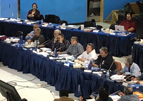 Charlie Watt, centre and in grey, addresses Makivik's annual general meeting in Puvirnituq last month, where board members passed a resolution again calling on the Quebec government to exempt the region from its firearms registry. (PHOTO COURTESY OF MAKIVIK)