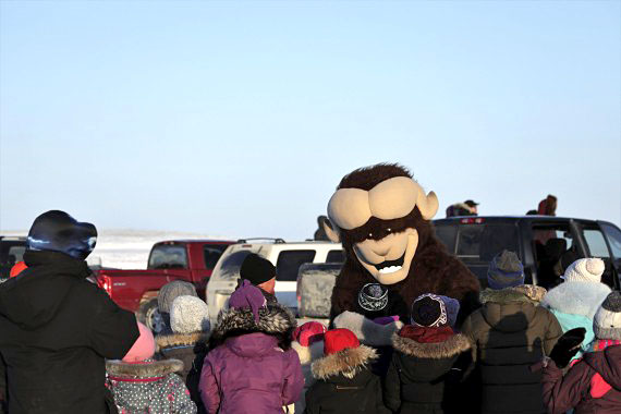 Ollie the muskox, the mascot of Cambridge Bay's Omingmak Frolics spring festival, greets residents on Friday, May 4. (PHOTO BY DERRICK ANDERSON/RED SUN PRODUCTIONS)