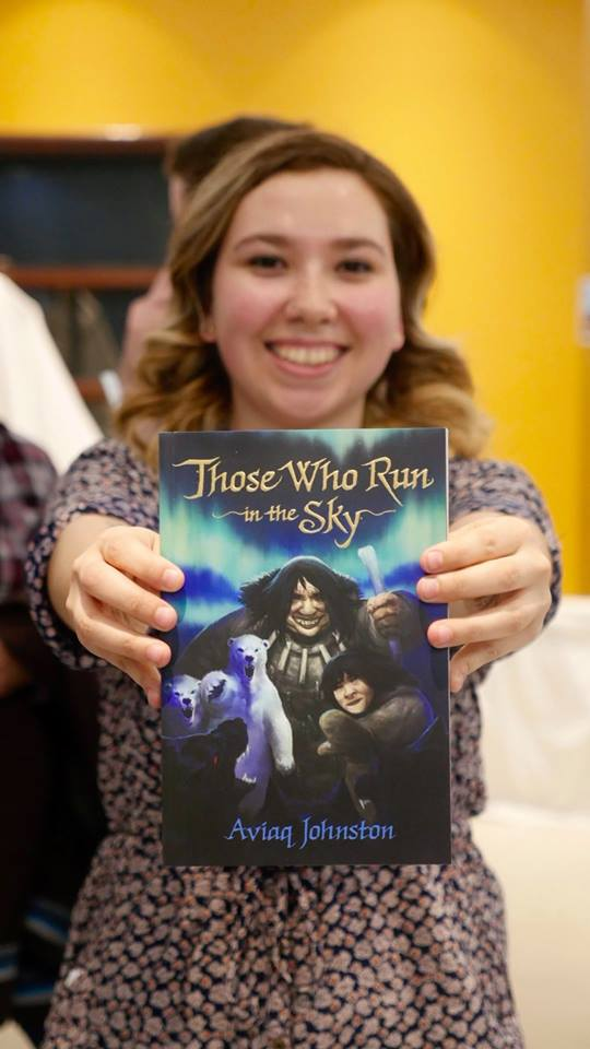 "Aviaq Johnston holds up a copy of her young adult novel, Those Who run in the Sky, which has been nominated for an award for ""most significant work of prose in English by an emerging Indigenous writer"" from the Indigenous Voices Awards. (PHOTO BY NICK CASTEL)"