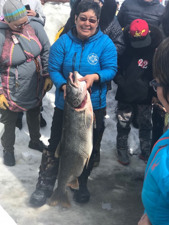 Donna Adams happily displays her prize-winning catch at the Rankin Inlet fishing derby that took place on the May long weekend. (PHOTO BY KELLI MCLARTY)