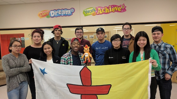 Nunavut and Northwest Territories youth ambassadors pose with a Nunavut flag on their way to help with the 2017 Canada Games in Winnipeg. The Canada Games are among the events supported by the Youth Ambassador Program. (PHOTO COURTESY OF THE CANADA GAMES)