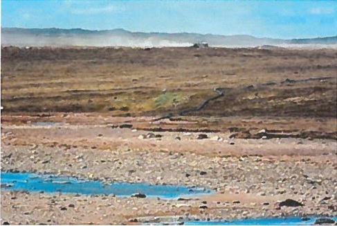 Former Rankin Inlet MLA Tom Sammurtok tabled this photo in 2016 of Rankin Inlet's fresh water source, Lake Nipissar, to show the lake's alarmingly low water levels. Residents of the Kivalliq community are dealing with discoloured tap water, which officials say could be mixed with mud or sand.