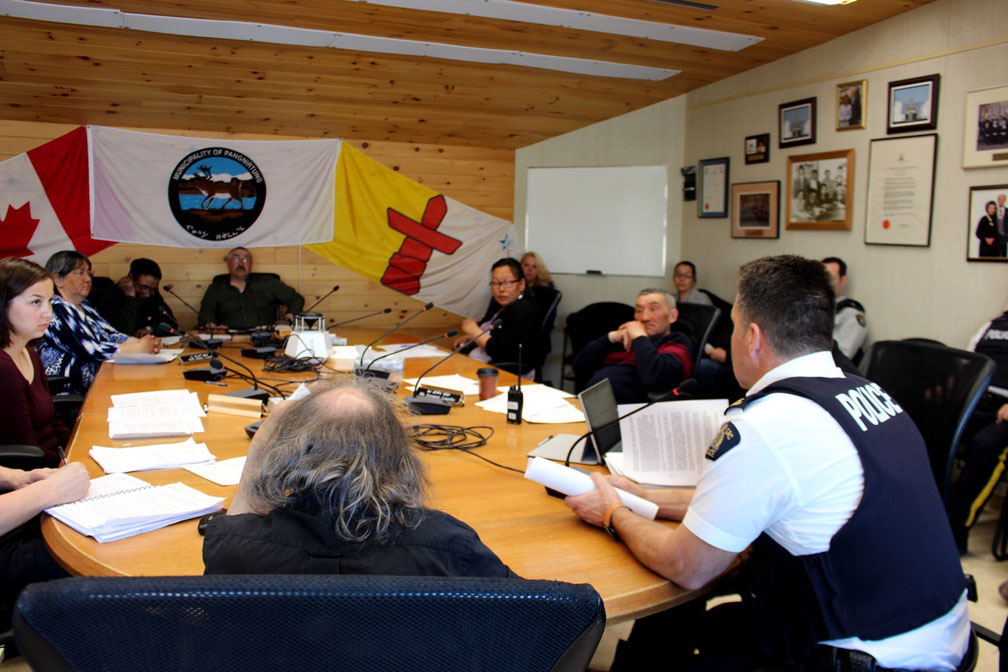 Civil servants from the Nunavut government, along with RCMP representatives, met with hamlet representatives in Pangnirtung last night. The hamlet has developed a five-year