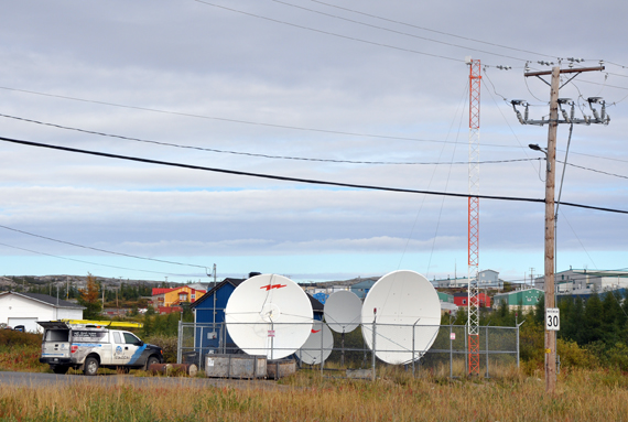 A Tamaani technician checks out some of the service providers' equipment in Kuujjuaq during upgrades done in 2015 to implement 4G technology throughout the region. Starting next month, Tamaani and Ice Wireless will deliver cellular services to all 14 Nunavik communities. (FILE PHOTO)