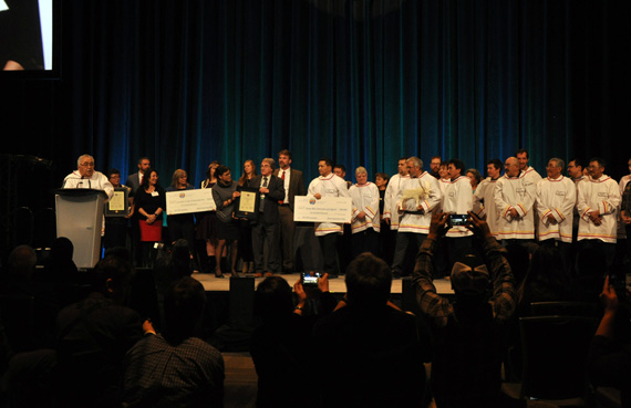 Members of Unaaq Men's Association of Inukjuak stand on stage to receive their $500,000 Arctic Inspiration Prize win last year. (FILE PHOTO)