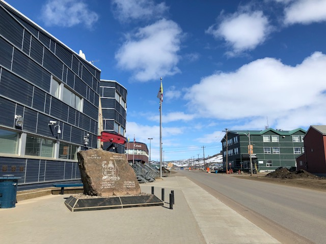 Under sunny skies on June 8 in Iqaluit, MLAs discussed the budget of the Nunavut Housing Corp. inside the assembly chamber of the territorial legislature. (PHOTO BY JANE GEORGE)