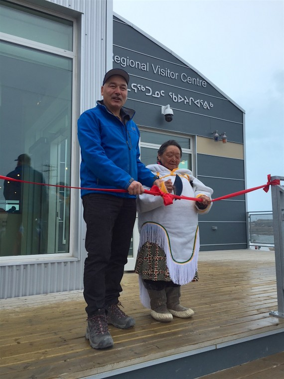 Premier Joe Savikataaq cuts a ribbon with Rankin Inlet elder Monica Ugjuk at the opening of the Kivalliq Regional Visitor Centre June 16. (PHOTO COURTESY OF THE GOVERNMENT OF NUNAVUT)