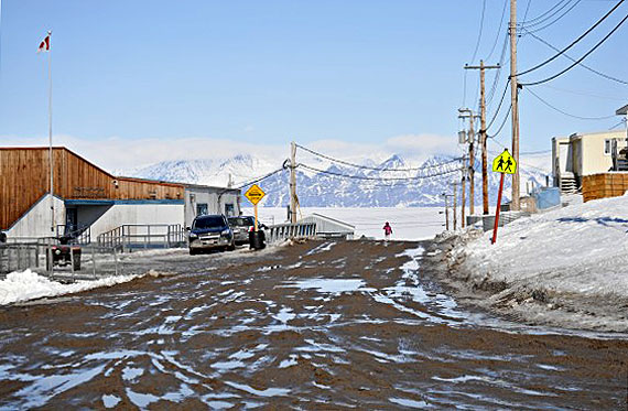 Rain boots required! As the snow melts, the roads turn to mud in Pond Inlet on May 22. (PHOTO BY NORMAN KOONOO)