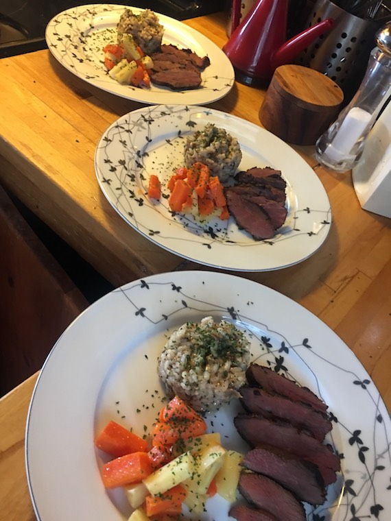 A five-pound Canada goose can easily feed four: here are three of the plates that Lumsden prepared along with vegetables and risotto. (PHOTO BY SHEILA LUMSDEN)