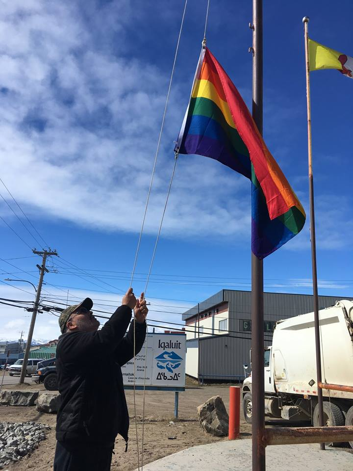 City of Iqaluit facility worker Mike Giles raises the pride flag at Iqaluit city hall Thursday morning, June 28. City council voted at its last meeting to raise the flag for Pride Month, June, as a way to acknowledge the presence and rights of the lesbian, gay, bisexual, transgender and queer community. (PHOTO COURTESY OF THE CITY OF IQALUIT)