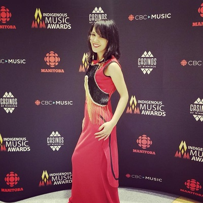 Nunavut singer Kelly Fraser models Kyak's sealskin sakiaguti as an embellisment over her dress at the recent Indigenous Music Awards in Winnipeg. The dress was made by Melissa Attagutsiak. (PHOTO COURTESY OF K. FRASER)