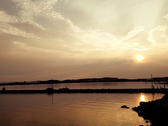 Susie Baines caught this image of the sinking sun painting the waters gold near the Iqaluit breakwater sometime between 8 and 9 p.m. on July 13. (PHOTO COURTESY OF SUSIE BAINES)